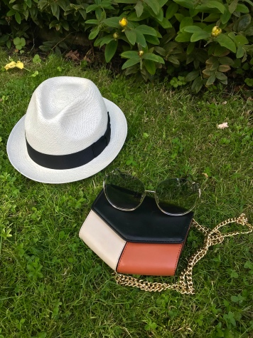 Key summer accessories: Panama hat, mini bag in key neutral shades and Oversized transparent sunnies.